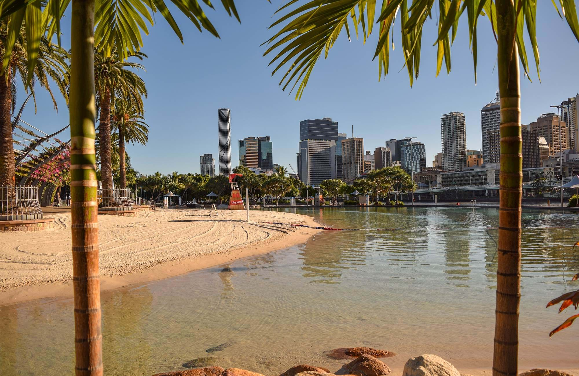 brisbane-view-of-the-south-bank-artificial-beach-and-the-city-skyline-cover